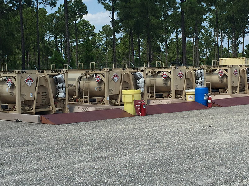 Tri-Star MAX Spill Containment System forming a containment station for tankers in storage.